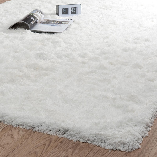 Tapis blanc poils long maisons du monde pickture for Tapis de fourrure blanc ikea